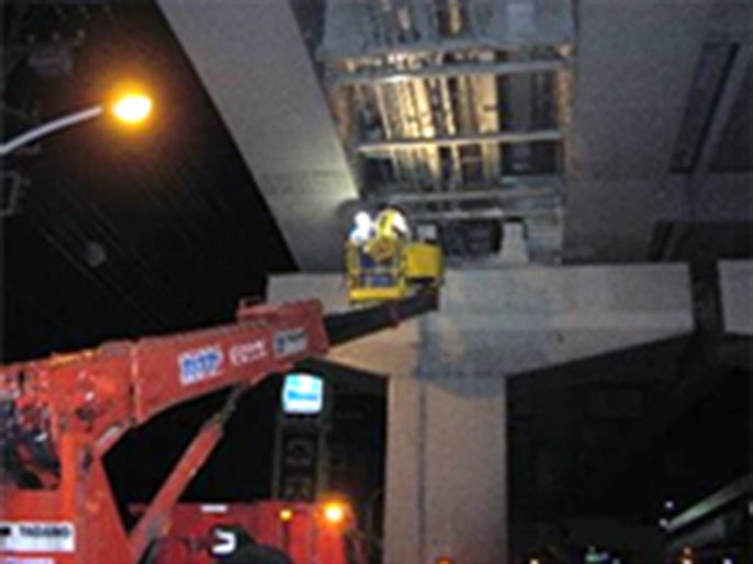 Close inspection of overpass using aerial work platform